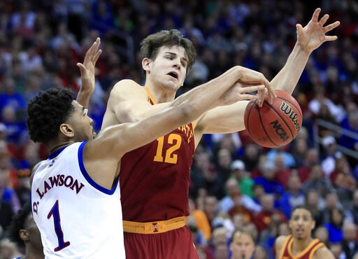 (AP Photo/Orlin Wagner). Kansas forward Dedric Lawson (1) blocks a shot by Iowa State forward Michael Jacobson (12) during the second half of an NCAA college basketball game in the final of the Big 12 men's tournament in Kansas City, Mo., Saturday, Mar...