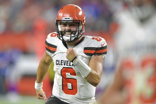 (AP Photo/David Richard, File). FILE - In this Aug. 17, 2018, file photo, Cleveland Browns quarterback Baker Mayfield celebrates in the second half of the team's NFL football preseason game against the Buffalo Bills, in Cleveland. With a shocking, bloc...