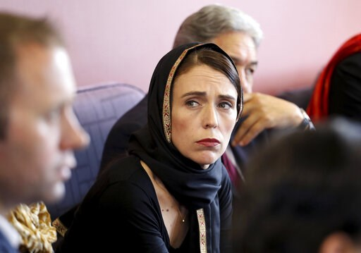 (New Zealand Prime Minister Office via AP). In this photo released by New Zealand Prime Minister's Office, Prime Minister Jacinda Ardern, center, meets representatives of the Muslim community, Saturday, March 16, 2019, at the Canterbury Refugee Centre ...