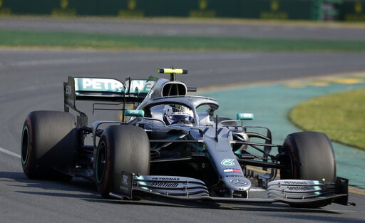 (AP Photo/Rick Rycroft). Mercedes driver Valtteri Bottas of Finland goes through turn 2 as he leads during the Australian Formula 1 Grand Prix in Melbourne, Australia, Sunday, March 17, 2019.