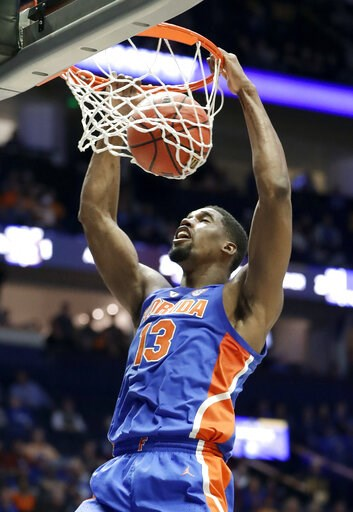 (AP Photo/Mark Humphrey). Florida center Kevarrius Hayes dunks the ball against Auburn in the first half of an NCAA college basketball game at the Southeastern Conference tournament Saturday, March 16, 2019, in Nashville, Tenn.