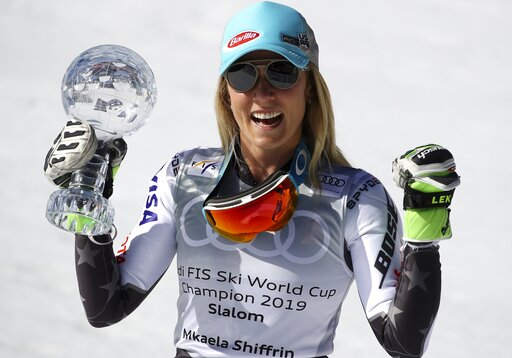 (AP Photo/Alessandro Trovati). United States' Mikaela Shiffrin holds the women's World Cup slalom' discipline trophy, at the alpine ski, World Cup finals in Soldeu, Andorra, Saturday, March 16, 2019.