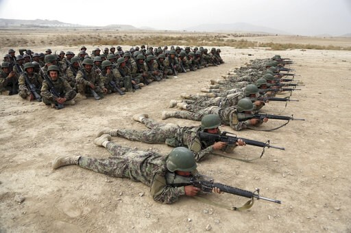 (AP Photo/Rahmat Gul, File). FILE - In this Oct. 31, 2018, photo, Afghan National Army soldiers carry out an exercise during a live firing at the Afghan Military Academy in Kabul, Afghanistan. Afghan officials say around 100 soldiers fled their posts a...