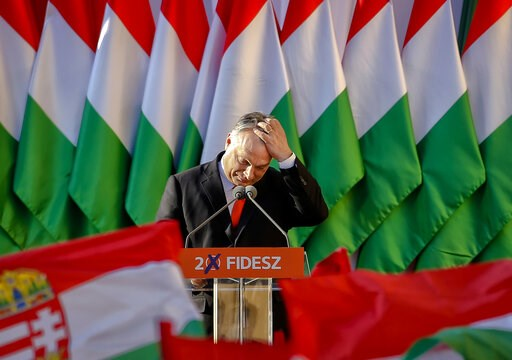 (AP Photo/Darko Vojinovic, File). FILE - In this Friday, April 6, 2018, file photo, Prime Minister Viktor Orban's pauses while delivering a speech during the final electoral rally of his Fidesz party in Szekesfehervar, Hungary. As the Hungarian prime m...