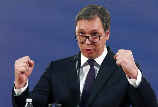 (AP Photo/Darko Vojinovic). Serbia's President Aleksandar Vucic speaks during a press conference in Belgrade, Serbia, Sunday, March 17, 2019. Vucic has pledged to defend the country's law and order a day after opposition supporters stormed the national...