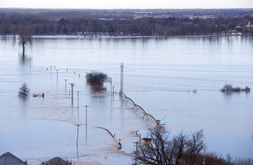 (Jeff Bundy/Omaha World-Herald via AP). Looking southwest towards Waterloo Neb., high waters from the Elkhorn river cover Maple street in the distance Saturday March 16, 2019.  The flooding followed days of snow and rain — record-setting, in some place...