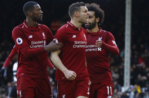 (AP Photo/Kirsty Wigglesworth). Liverpool's James Milner, center, celebrates with teammates Georginio Wijnaldum, left, and Mohamed Salah after scoring his side's second goal, during the English Premier League soccer match between Fulham and Liverpool a...