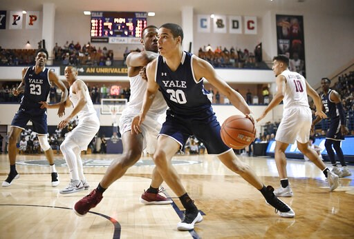 (AP Photo/Jessica Hill). Yale's Paul Atkinson, front, dribbles as Harvard's Chris Lewis, back, defends during the first half of an NCAA college basketball game for the Ivy League championship at Yale University in New Haven, Conn., Sunday, March 17, 20...