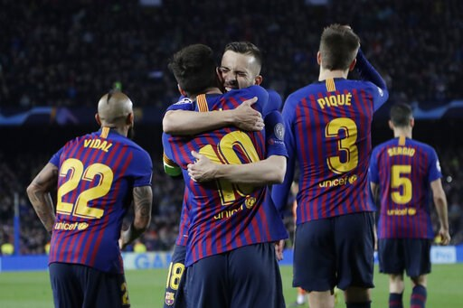 (AP Photo/Emilio Morenatti). Barcelona's Lionel Messi, centre, is hugged by Jordi Alba after scoring his side's third goal during the Champions League round of 16, 2nd leg, soccer match between FC Barcelona and Olympique Lyon at the Camp Nou stadium in...
