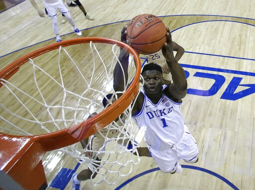(AP Photo/Chuck Burton). Duke's Zion Williamson (1) goes up to dunk against Florida State during the first half of the NCAA college basketball championship game of the Atlantic Coast Conference tournament in Charlotte, N.C., Saturday, March 16, 2019.