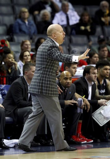 (AP Photo/Troy Glasgow). Cincinnati coach Mick Cronin shouts to his players during the first half of the team's NCAA college basketball game against Houston in the American Athletic Conference men's tournament final Sunday, March 17, 2019, in Memphis, ...