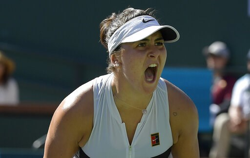 (AP Photo/Mark J. Terrill). Bianca Andreescu, of Canada, celebrates after winning a game against Angelique Kerber, of Germany, during the women's final at the BNP Paribas Open tennis tournament Sunday, March 17, 2019, in Indian Wells, Calif.