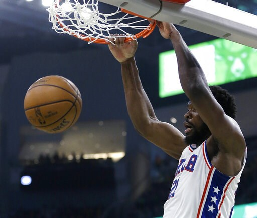 (AP Photo/Aaron Gash). Philadelphia 76ers' Joel Embiid dunks during the first half of the team's NBA basketball game against the Milwaukee Bucks on Sunday, March 17, 2019, in Milwaukee.