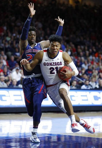 (AP Photo/John Locher). Gonzaga's Rui Hachimura drives into St. Mary's Malik Fitts during the first half of an NCAA college basketball game for the West Coast Conference men's tournament title, Tuesday, March 12, 2019, in Las Vegas.