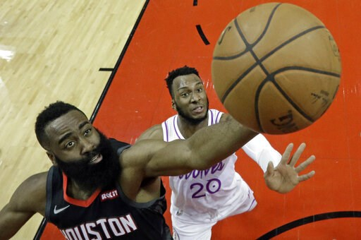 (AP Photo/David J. Phillip). Houston Rockets' James Harden, left, shoots as Minnesota Timberwolves' Josh Okogie (20) defends during the first half of an NBA basketball game Sunday, March 17, 2019, in Houston.