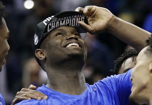 (AP Photo/Chuck Burton). Duke's Zion Williamson celebrates after Duke defeated Florida State in the NCAA college basketball championship game of the Atlantic Coast Conference tournament in Charlotte, N.C., Saturday, March 16, 2019. Williamson was named...