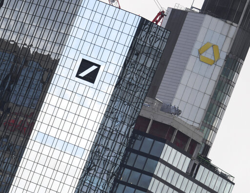 (Arne Dedert/dpa via AP). File-Picture taken March 11, 2019 shows the head offices of Deutsche Bank, left, and Commerzbank, right.