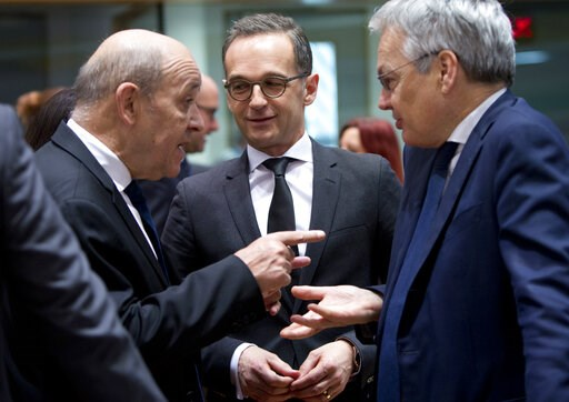 (AP Photo/Virginia Mayo). French Foreign Minister Jean-Yves Le Drian, left, speaks with German Foreign Minister Heiko Maas, center, and Belgian Foreign Minister Didier Reynders, right, during a meeting of EU foreign ministers at the EU Council building...