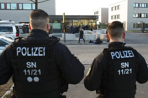 (AP Photo/Jens Meyer). Police Officers stand in front of the court entrance prior the beginning of the trial against Alaa S. of Syria in the higher regional court in Dresden, Germany, Monday, March 18, 2019. The asylum seeker is accused together with n...