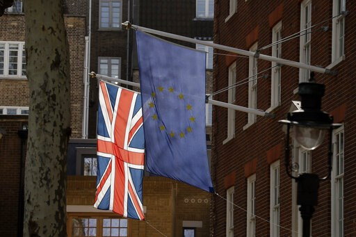 (AP Photo/Matt Dunham). A European flag and a British Union flag hang outside Europe House, the European Parliament's British offices in London, Monday, March 18, 2019. British Prime Minister Theresa May was making a last-minute push Monday to win supp...
