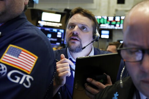(AP Photo/Richard Drew, File). FILE- In this March 12, 2019, file photo, trader Michael Milano works on the floor of the New York Stock Exchange. The U.S. stock market opens at 9:30 a.m. EDT on Monday, March 18.