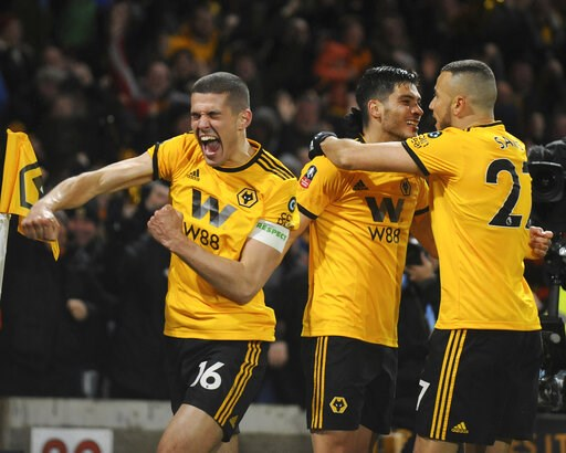 (AP Photo/Rui Vieira). Wolverhampton's Raul Jimenez, centre, celebrates with teammates after scoring his side's opening goal during the English FA Cup Quarter Final soccer match between Wolverhampton Wanderers and Manchester United at the Molineux Stad...