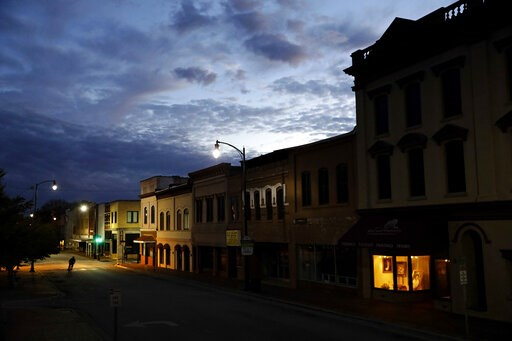 (AP Photo/David Goldman, File). FILE- In this Oct. 28, 2017, file photo the storefront window of a portrait studio is lit up along a downtown street at dusk in Lumberton, N.C. Although small businesses vary widely in terms of size, industry and issues,...