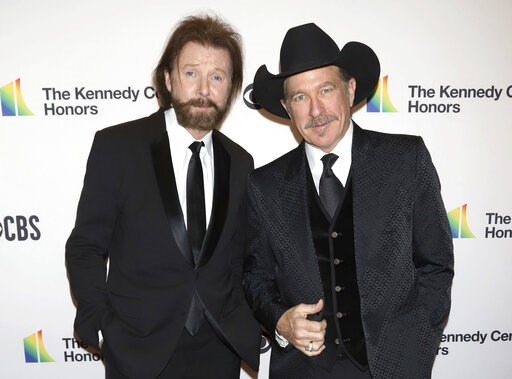 (Photo by Greg Allen/Invision/AP, File). FILE - In this Dec. 2, 2018 file photo, Ronnie Dunn, left, and Kix Brooks attend the 41st Annual Kennedy Center Honors in Washington. Brooks & Dunn, comedic singer Ray Stevens and industry veteran Jerry Brad...