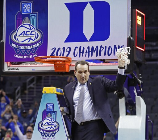 (AP Photo/Nell Redmond). Duke head coach Mike Krzyzewski celebrates Duke's win over Florida State after cutting down a net after the NCAA college basketball championship game of the Atlantic Coast Conference tournament in Charlotte, N.C., Saturday, Mar...