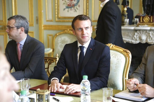 (Ludovic Marin/Pool Photo via AP). French President Emmanuel Macron flanked by Elysee general secretary Alexis Kohler, left, holds a meeting at the Elysee presidential Palace, in Paris, Monday, March 18, 2019. Macron summoned top security officials Mon...
