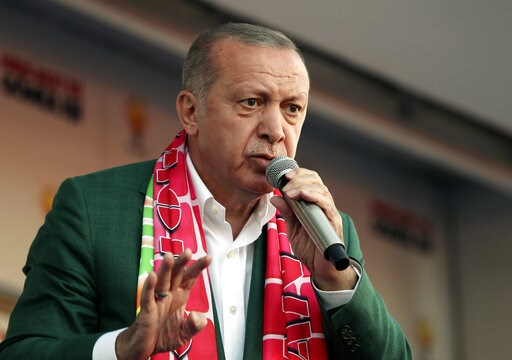 (Presidential Press Service via AP, Pool). In this photo taken on Sunday, March 17, 2019, Turkey's President Recep Tayyip Erdogan addresses the supporters of his ruling Justice and Development Party during a rally in Antalya, Turkey. Erdogan has screen...