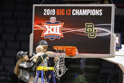 (AP Photo/Alonzo Adams). Baylor head coach Kim Mulkey holds her grandson, assisted by her daughter Makenzie Fuller, as she cuts down the nets after Baylor defeated Iowa State during the Big 12 women's conference tournament championship in Oklahoma City...