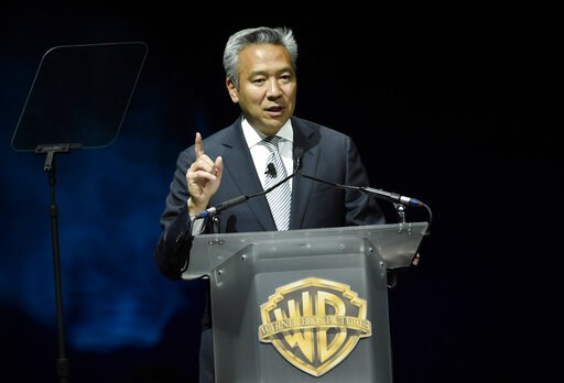 (Photo by Chris Pizzello/Invision/AP, File). FILE - This April 21, 2015 file photo shows Kevin Tsujihara, chairman and CEO of Warner Bros., during the Warner Bros. presentation at CinemaCon 2015 in Las Vegas. Tsujihara is stepping down after claims tha...