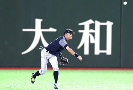 (AP Photo/Eugene Hoshiko). Seattle Mariners' Ichiro Suzuki warms up during his team's practice at Tokyo Dome in Tokyo Saturday, March 16, 2019. The Mariners will play in a two-baseball game series against the Oakland Athletics to open the Major League ...