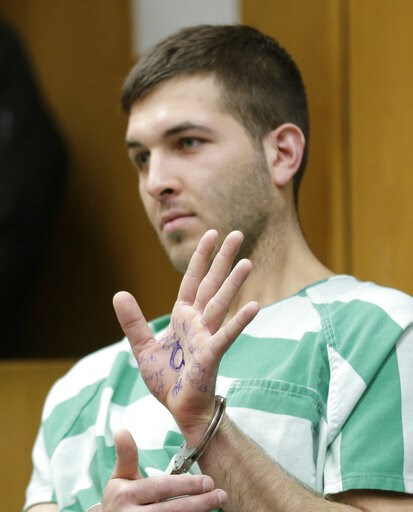 (AP Photo/Seth Wenig). Anthony Comello displays writing on his hand during his extradition hearing in Toms River, N.J., Monday, March 18, 2019. New York City police say a suspect is in custody in the shooting death of the reputed Gambino crime family b...