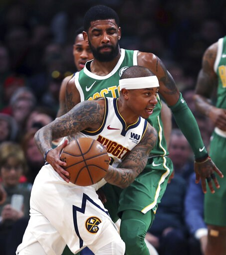 (AP Photo/Charles Krupa). Denver Nuggets guard Isaiah Thomas drives past Boston Celtics guard Kyrie Irving, rear, during the first quarter of an NBA basketball game in Boston, Monday, March 18, 2019. Thomas returned to play in his first game after bein...