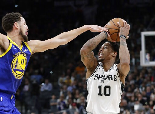 (AP Photo/Eric Gay). San Antonio Spurs guard DeMar DeRozan (10) shoots against Golden State Warriors guard Klay Thompson (11) during the second half of an NBA basketball game in San Antonio, Monday, March 18, 2019.