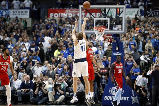(AP Photo/Tony Gutierrez). Dallas Mavericks forward Dirk Nowitzki (41) shoots as New Orleans Pelicans' Kenrich Williams (3) defends and Pelicans' Julius Randle (30) and Anthony Davis (23) watch in the first half of an NBA basketball game in Dallas, Mon...