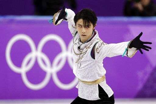 (AP Photo/David J. Phillip, File). FILE - In this Feb. 17, 2018, file photo, Yuzuru Hanyu of Japan performs during the men's free figure skating final in the Gangneung Ice Arena at the 2018 Winter Olympics in Gangneung, South Korea. Hanyu is recovering...