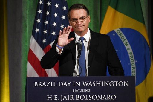 (AP Photo/Susan Walsh). Brazilian President Jair Bolsonaro speaks at the Chamber of Commerce in Washington, Monday, March 18, 2019.