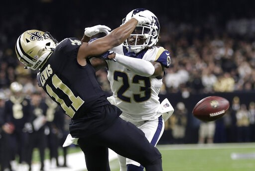 (AP Photo/Gerald Herbert, File). FILE - In this Jan. 20, 2019, file photo, Los Angeles Rams' Nickell Robey-Coleman (23) breaks up a pass intended for New Orleans Saints' Tommylee Lewis during the second half of the NFL football NFC championship game in...