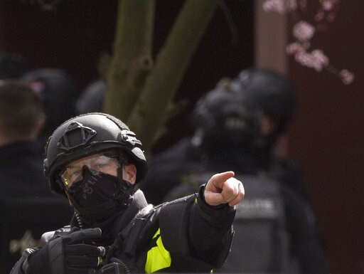 (AP Photo/Peter Dejong). Dutch counter terrorism police prepare to enter a house after a shooting incident in Utrecht, Netherlands, Monday, March 18, 2019. A gunman killed three people and wounded nine others on a tram in the central Dutch city of Utre...