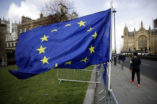 (AP Photo/Matt Dunham). A European flag placed by anti-Brexit remain in the European Union supporters flies backdropped by the Houses of Parliament, at right, in London, Monday, March 18, 2019. British Prime Minister Theresa May was making a last-minut...