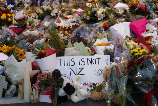 (AP Photo/Vincent Yu, File). In this Saturday, March 16, 2019, file photo, flowers lay at a memorial near the Masjid Al Noor mosque for victims in last week's shooting in Christchurch, New Zealand. The leafy New Zealand city where a self-proclaimed rac...