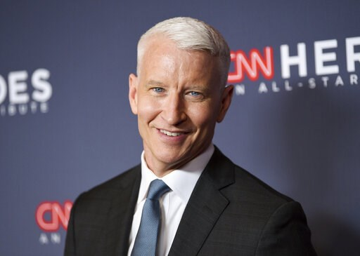 (Photo by Evan Agostini/Invision/AP, File). FILE - In this Dec. 9, 2018 file photo, host Anderson Cooper attends the 12th annual CNN Heroes: An All-Star Tribute at the American Museum of Natural History, in New York. Cooper has a 2-book deal and plans ...