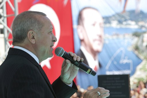(Presidential Press Service via AP, Pool). Turkey's President Recep Tayyip Erdogan addresses the supporters of his ruling Justice and Development Party during a rally in Eregli, Turkey, Tuesday, March 19, 2019. Ignoring widespread criticism, Erdogan ha...