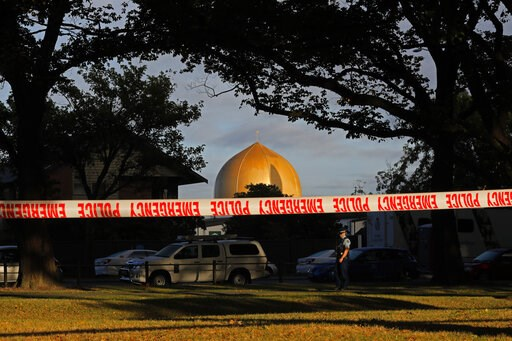 (AP Photo/Vincent Yu). A police officer stands guard in front of the Masjid Al Noor mosque in Christchurch, New Zealand, Sunday, March 17, 2019, where one of two mass shootings occurred. New Zealand's stricken residents reached out to Muslims in their ...