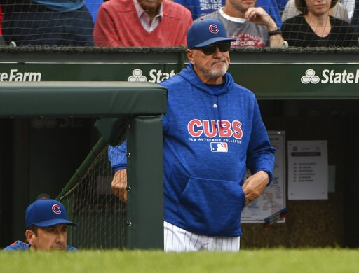 (AP Photo/Matt Marton, File). FILE - In this Oct. 1, 2018, file photo, Chicago Cubs manager Joe Maddon (70) looks on after Milwaukee Brewers' Domingo Santana (16) scores during the eighth inning of a tie break baseball game against the Chicago Cubs in ...