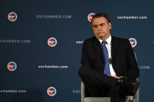 (AP Photo/Susan Walsh). Brazilian President Jair Bolsonaro waits to speak at the Chamber of Commerce in Washington, Monday, March 18, 2019.