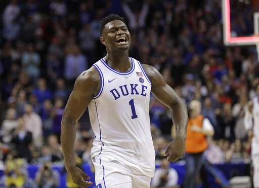 (AP Photo/Nell Redmond). Duke's Zion Williamson (1) celebrates after Duke defeated Florida State in the NCAA college basketball championship game of the Atlantic Coast Conference tournament in Charlotte, N.C., Saturday, March 16, 2019.